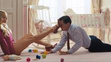 Margot Robbie and Leonardo DiCaprio in an scence from The Wolf of Wall Street.