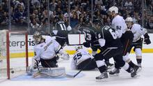 Los Angeles Kings defenseman Jake Muzzin scores a goal past Anaheim Ducks goalie John Gibson (Kirby Lee/USA TODAY Sports)