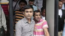 Tahmid Hasib Khan, center in blue jeans, an undergraduate at the University of Toronto who has Canadian residency, comes out after a court appearance, in Dhaka, Bangladesh Wednesday, Oct. 5, 2016. (AP)