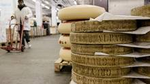 Many European dairy farms – which send cheese products such as wheels of Gruyere to markets such as Rungis wholesale food market in Rungis, France – are more competitive than our farms in Canada. (Marlene Awaad/Bloomberg)