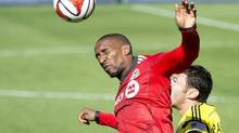 Jermain Defoe, left, has scored 11 times for TFC this year, but has never quite settled in at Toronto FC. (Nathan Denette/THE CANADIAN PRESS)