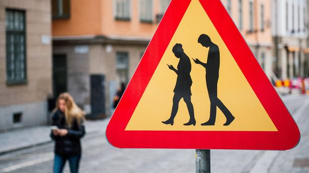 Stockholm has erected road signs warning pedestrians against focusing on their smartphones while walking.