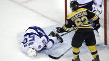 Tampa Bay Lightning defenseman Jake Dotchin lies on the ice after an altercation with Boston Bruins left wing Brad Marchand during the first period of an NHL hockey game in Boston, Tuesday, April 4, 2017. (Charles Krupa/AP)