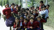 """More than thirty-five Indian children sit at the horse cart while coming back from school at the outskirts of New Delhi on February 26, 2001. The number of primary schools increased by 180 per cent from 210 thousand in 1951 to 590 thousand in 1996. Nevertheless, according to the report on """"Human Development in South Asia, 1998"""", India has the largest illiterate population in the world - 424 million, which exceeds the total combined population of the North American continent and Japan. (Pawel Kopczynski/Reuters/Pawel Kopczynski/Reuters)"""