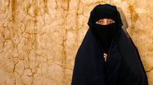A woman in Kandahar wears a black chaderi covering, revealing only her eyes. (Paula Lerner/© Paula Lerner 2009)