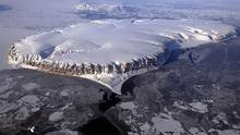 Ice-capped Saunder's Island ringed by a layer of thin sea ice in Baffin Bay. The National Energy Board approved a plan last June by a Norwegian company, Petroleum Geo-Services Inc., to undertake seismic work in the Baffin Bay and Davis Strait off Nunavut over the course of the next five years. (Michael Studinger/NASA)