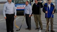 Prime Minister Stephen Harper is seen with Conservative staffers, left to right, Dimitri Soudas, Mike Beaton and Ray Novak following an impromptu ball-hockey game on the tarmac prior to boarding his campaign plane in Kitchener Ont., on April 9, 2011. (Sean Kilpatrick/The Canadian Press)