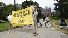 People protest the dumping of mercury on the Grassy Narrows First Nation at Queen's Park on June 23, 2016. (Fred Lum/The Globe and Mail)