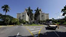 A convertible enters Havana's Hotel Nacional Oct. 21, 2012. President Raul Castro wants to transform the country's Soviet-style command economy into one more in line with Asian Communism to allow private enterprise. (Desmond Boylan/Reuters)