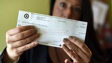 Market researcher Tanya Vierhuis, who owns her own firm, couldn't cash an $18,000 cheque from Target that was dated Jan. 13. (Fred Lum/The Globe and Mail)