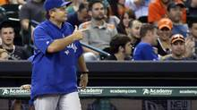 Toronto Blue Jays manager John Gibbons points to the bullpen as he heads out to the mound to relieve starting pitcher Todd Redmond in the fourth inning of a baseball game against the Houston Astros in Houston on Aug. 23, 2013. Gibbons has been an easy target given that his club took a poor 58-73 record into Monday's series opener against New York. (Pat Sullivan/AP)