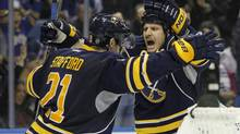 Buffalo Sabres center Steve Ott (9) celebrates his goal against the Toronto Maple Leafs with Buffalo Sabres right wing Drew Stafford (21) during the second period at First Niagara Center. Mandat (KEVIN HOFFMAN/USA TODAY SPORTS)