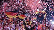 Soccer fans react during a public screening after Germany won their Euro 2012 quarter-final soccer match against Greece, in Berlin June 22, 2012. (TOBIAS SCHWARZ/REUTERS)