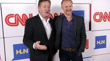 "Piers Morgan, left, host of the CNN show ""Piers Morgan Live"" and Morgan Spurlock of the CNN series ""Inside Man"" pose together at the CNN Worldwide All-Star Party, on Friday, Jan. 10, 2014, in Pasadena, Calif. (Chris Pizzello/Invision/AP)"