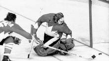 Team Canada players and members of the Russian National Hockey Club during Game 4 of the Canada-Russia Summit Series played in Vancouver, Sept. 8, 1972. Team Canada player Don Awrey reaches for the puck that stopped just short of the goalline behind Team Canada goalie Ken Dryden. The Russians won the fourth game of ther series 5-3. Dryden argues that the model for professional hockey without fighting is in front of us. (CP)