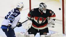 The Winnipeg Jets Alexei Ponikarovsky (L) scores the only goal of the game on Ottawa Senators goalie Ben Bishop during the third period of their NHL hockey game at Scotiabank Place in Ottawa, February 9, 2013. (Reuters)
