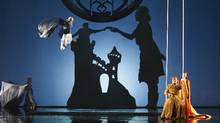 Russell Braun as Jaufr (left, on swing) in the Canadian Opera Company production of Love from Afar, 2012. (MICHAEL COOPER/MICHAEL COOPER)