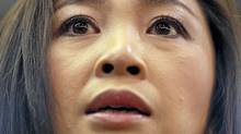 Prime Minister-elect Yingluck Shinawatra of the Puea Thai Party addresses reporters at her party's headquarters in Bangkok on July 5, 2011. (DAMIR SAGOLJ/REUTERS/DAMIR SAGOLJ/REUTERS)