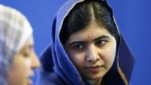 Malala Yousafzai became an international symbol for girls' rights after surviving a 2012 attack by a Taliban gunman. (DARREN STAPLES/REUTERS)