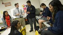 Farah Heron, left, leads a group of Reconnecting Youth participants at R.H. King Academy in Toronto. (Kevin Van Paassen/The Globe and Mail)