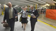 TTC chief executive officer Andy Byford assists commuters facing the use of a new second subway platform for the first time at Union Station during the morning rush August 18 , 2014. (J.P. Moczulski For The Globe and Mail)