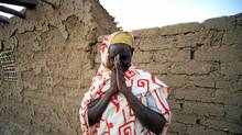 A Southern Sudanese woman who decided to stay in north Sudan gestures at her house at the Hadj Yoasf district in Khartoum on Jan. 6, 2011. (MOHAMED NURELDIN ABDALLAH/MOHAMED NURELDIN ABDALLAH/REUTERS)