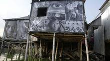 Photographs of garment workers in Dhaka on stilt houses. REUTERS/Andrew Biraj (BANGLADESH - Tags: SOCIETY BUSINESS TEXTILE EMPLOYMENT) (ANDREW BIRAJ/REUTERS)