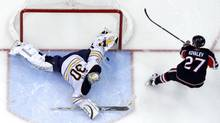 Buffalo Sabres' goalie Ryan Miller stops Ottawa Senators' Alex Kovalev's shot on net in a shootout during their NHL hockey game in Ottawa December 4, 2010. (BLAIR GABLE/REUTERS)