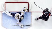 Buffalo Sabres' goalie Ryan Miller stops Ottawa Senators' Alex Kovalev's shot on net in a shootout during their NHL hockey game in Ottawa December 4, 2010. (BLAIR GABLE/REUTERS)