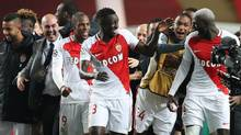 Monaco's players celebrate after advancing to the Champions League quarter-finals following a 3-1 win over Manchester City. (VALERY HACHE/AFP/Getty Images)