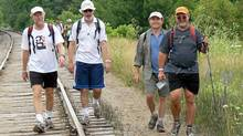 Frank Archibald, left, Dave Morritt, Randy Pepper and Tim Belanger take part in the 100-kilometre Trailwlker hike to raise money for Oxfam Canada.