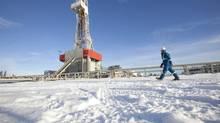 A Nexen worker walks past a shale-gas drilling rig in the Etsho area of northeastern B.C. (Dave Olecko/Nexen)