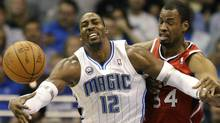 Orlando Magic center Dwight Howard (L) loses the ball against Atlanta Hawks center Jason Collins during the first half of Game 2 of their NBA Eastern Conference first round playoff basket ball game in Orlando, Florida April 19, 2011. REUTERS/Kevin Kolczynski (Kevin Kolczynski/Reuters)