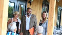 NDP leader Thomas Mulcair (C ) his wife Catherine (L ) and local MP Ruth Ellen Brosseau (R ) meet visitors at the Ferme Nouvelle-France, in Ste-Angele-de-Premont, Quebec on August 8, 2014 (Christinne Muschi For the Globe and Mail)