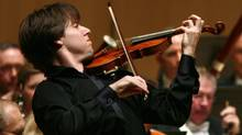 Violinist Joshua Bell gave the TSO audience a masterclass in effective, virtuosic playing in Edouard Lalo's Symphonie Espagnole. (Fernando Morales/The Globe and Mail)