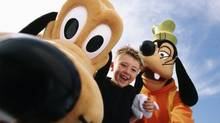 Young boy with Goofy and Pluto at Disney World (Disney handout)