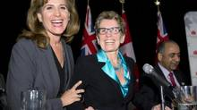 Ontario Liberal party leadership candidates Sandra Pupatello (left) and Kathleen Wynne share a laugh as Harinder Takhar (behind) packs his papers following a forum at the Canadian Club of Toronto in Toronto on Thursday December 6, 2012. (Frank Gunn/THE CANADIAN PRESS)