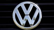 In this Sept. 21, 2015, file photo, a Volkswagen logo is seen on car offered for sale at New Century Volkswagen dealership in Glendale, Calif.