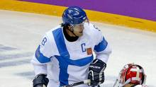 Teemu Selanne playing with the Finnish national hockey team at the 2014 Winter Olympics in Sochi, Russia. The country's national hockey program has retired the iconic forward's No. 8 jersey. (Mark Humphrey/AP)