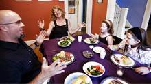 Matt Bonsall and Stephanie Small of Ottawa sit down for dinner with their daughters, Nettie, 7, and Daisy, 10. (Brigitte Bouvier)