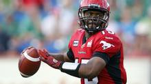 Calgary Stampeders' quarterback Kevin Glenn looks for a receiver during first quarter CFL action against the Saskatchewan Roughriders in Calgary, Alta., Thursday, July 19, 2012. (Jeff McIntosh/THE CANADIAN PRESS)