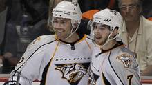 Nashville Predators center Mike Fisher (L) celebrates his second period goal with defenseman Jonathon Blum during Game 1 of the NHL Western Conference quarter-final hockey playoff against the Anaheim Ducks in Anaheim, California April 13, 2011. (MIKE BLAKE/REUTERS)