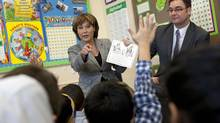 B.C. Premier Christy Clark and then-Education Minister Don McRae read a book to a Grade 2 class at K.B. Woodward Elementary School in Surrey in January 2013. (Deborah Baic/The Globe and Mail)