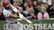 Arizona Diamondbacks' Justin Upton hits a home run during the third inning of Game 5 of baseball's National League division series against the Milwaukee Brewers Friday, Oct. 7, 2011, in Milwaukee. (AP Photo/David J. Phillip) (David J. Phillip/AP)