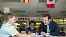 Dean Irvine the principal at Banff Elementary School, meets with some Grade four students in the library on Tuesday, April 29, 2014. (Chris Bolin For The Globe and Mail)