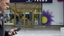 Telus is expected to post the lowest churn rate of the big three wireless providers. (Peter Power/The Globe and Mail)