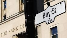 A Bay Street sign, a symbol of Canada's economic markets and where main financial institutions are located, is seen in Toronto, May 1, 2013. (Mark Blinch/Reuters)