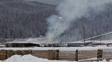 Smoke rises from the Abine Forest Products mill in Burns Lake, B.C. Saturday, Jan. 21, 2012. (JONATHAN HAYWARD/THE CANADIAN PRESS)