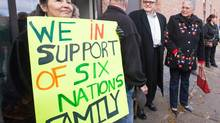 Chief Ava Hill of Six Nations, right, and Chief Bryan LaForme of Mississaugas of New Credit First Nation, second from right, speak outside the court on Nov 14, 2014.