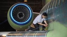 File photo of a Bombardier employee working on the assembly of a company jet. (Fred Lum/The Globe and Mail)